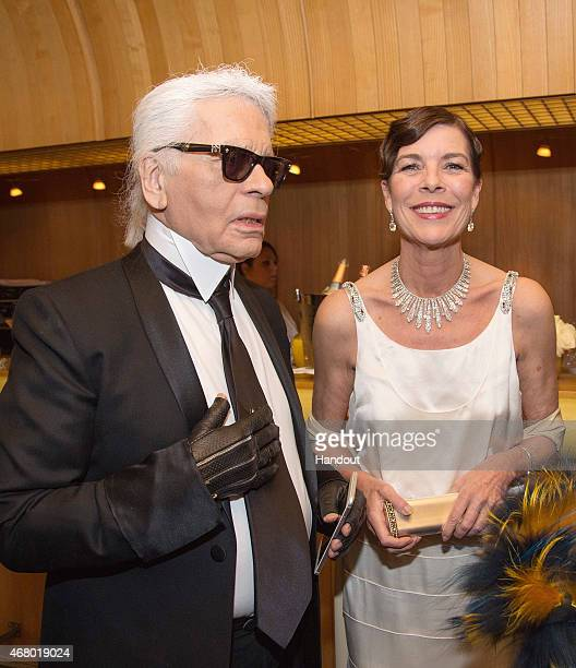 In this handout image provided by Le Palais Princier Princess Caroline of Hanover and Karl Lagerfeld attend the Rose Ball 2015 in aid of the Princess...