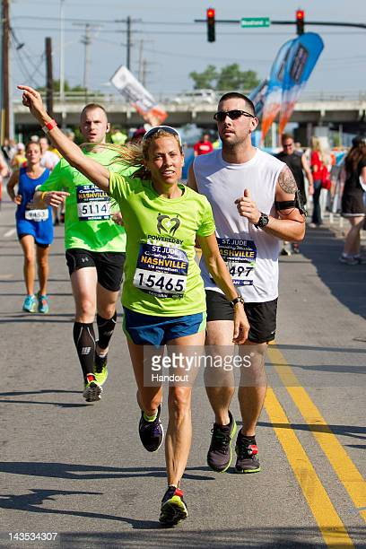 In this handout image provided by Lester Cacho Competitor Group Sheryl Crow participates in the St Jude Country Music Marathon 1/2 Marathon on April...