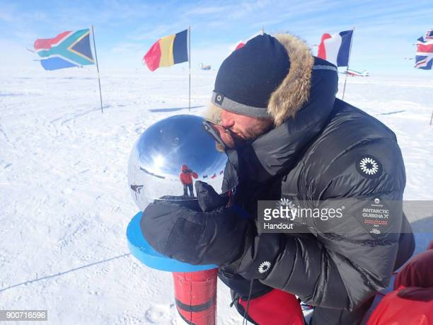 In this handout image provided by Lieutenant Scott Sears Lieutenant Scott Sears poses for a photo at the South Pole Antarctica having completed the...