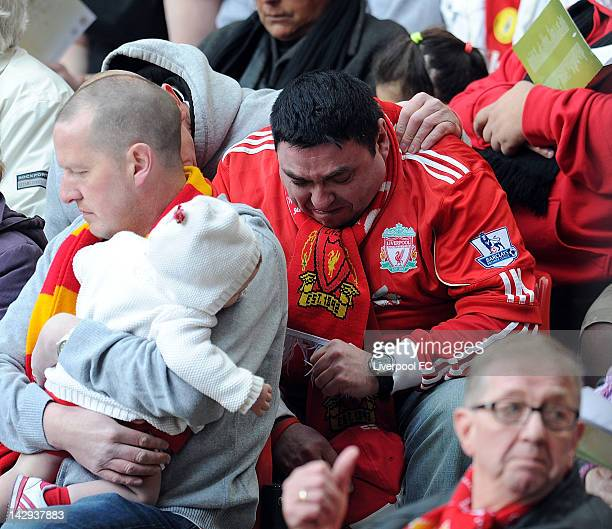 In this handout image provided by Liverpool FC a fan cries during a memorial service held to mark the 23rd anniversary of the Hillsborough disaster...