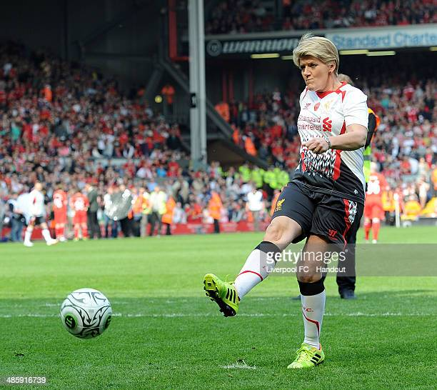 In this handout image provided by Liverpool FC Clare Balding of Liverpool takes a penalty during the celebration of the 96 Charity Match at Anfield...
