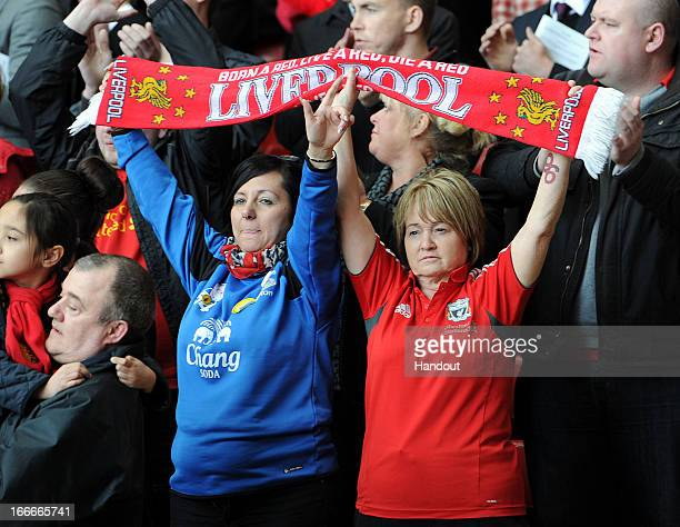 In this handout image provided by Liverpool FC Everton and Liverpool supporters hold team scarves aloft during the 24th Hillsborough Anniversary...