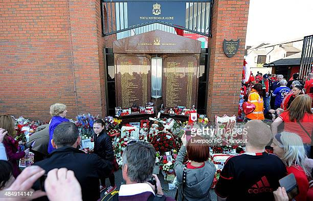 In this handout image provided by Liverpool FC fans gather at the Hillsborough memorial during the memorial service marking the 25th anniversary of...