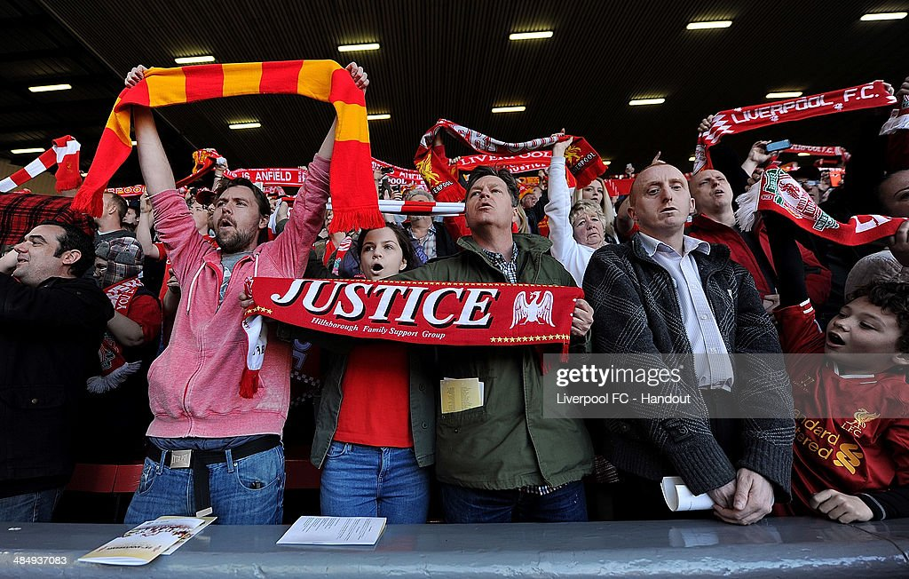 In this handout image provided by Liverpool FC, fans of Liverpool hold scarves aloft during the 25th Hillsborough Anniversary Memorial Service at Anfield on April 15, 2014 in Liverpool, England.