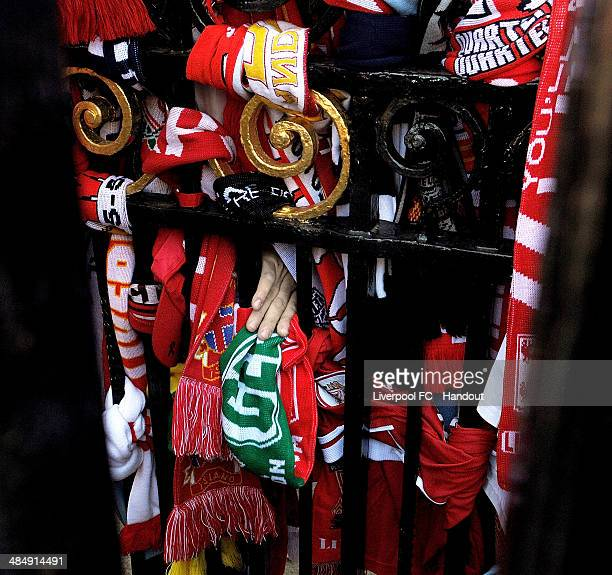 In this handout image provided by Liverpool FC football scarves and tributes are placed at the Hillsborough memorial during the memorial service...