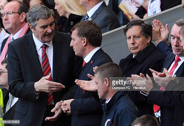 In this handout image provided by Liverpool FC former Liverpool player Ron Yeats talks with Brendan Rodgers manager of Liverpool during the 25th...
