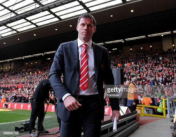 In this handout image provided by Liverpool FC Jamie Carragher of Liverpool attends the 24th Hillsborough Anniversary Memorial Service at Anfield on...