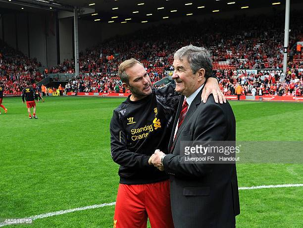 In this handout image provided by Liverpool FC Ron Yeats talks with Jason McAteer of Liverpool during the celebration of the 96 Charity Match at...