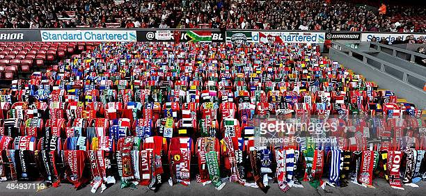 In this handout image provided by Liverpool FC scarves donated by football fans hang on seats during the 25th Hillsborough Anniversary Memorial...