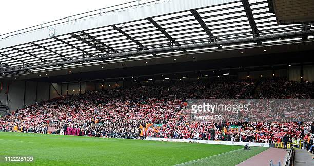 In this handout image provided by Liverpool FC spectators hold scarves aloft as they congregate in the Anfield Kop during the 22nd Hillsborough...
