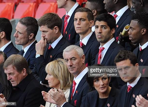 In this handout image provided by Liverpool FC Steven Gerrard Daniel Agger Luis Suarez Daniel Sturridge Kenny Dalglish Marina Dalglish and Ian Rush...