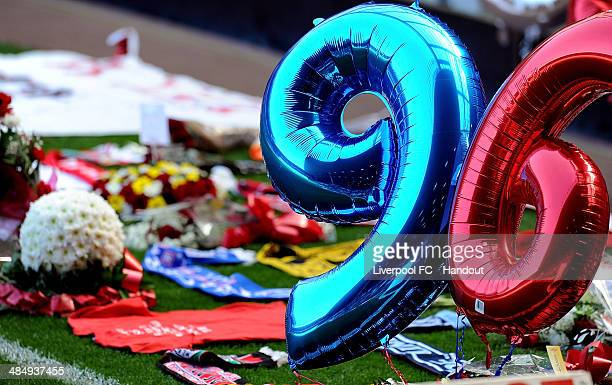 In this handout image provided by Liverpool FC tributes and balloons are left on the pitch during the 25th Hillsborough Anniversary Memorial Service...