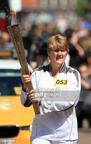In this handout image provided by LOCOG BBC sport presenter Torchbearer 053 Clare Balding carries the Olympic Flame on the Torch Relay leg through...