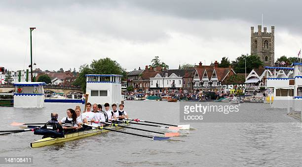 In this handout image provided by LOCOG Former Olympic gold medalist rower and Torchbearer Sir Steve Redgrave carries the Olympic Flame on a boat on...