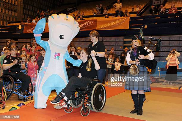 In this handout image provided by LOCOG, Official Paralympic mascot Mandeville with Chris Jacquin and his mum Mandy McDiarmid holding the Scottish...
