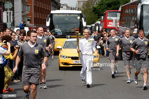 In this handout image provided by LOCOG, Torchbearer 037 and jockey Ruby Walsh carries the Olympic Flame on day 19 of the London 2012 Olympic Torch...