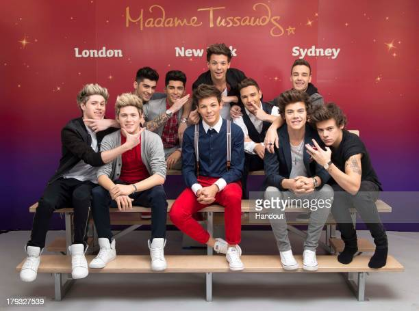 In this handout image provided by Madame Tussauds, Niall Horan, Zayn Malik, Louis Tomlinson, Liam Payne, and Harry Styles of One Direction pose...