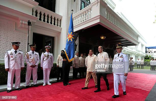 In this handout image provided by Malacanang Photo Bureau Outgoing President Benigno S Aquino III reviews the honor guards during the Departure...