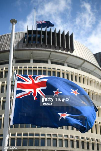 In this handout image provided by Mark Tantrum Photograph, New Zealand flags are seen at half mast on top of the Beehive on the tenth anniversary of...