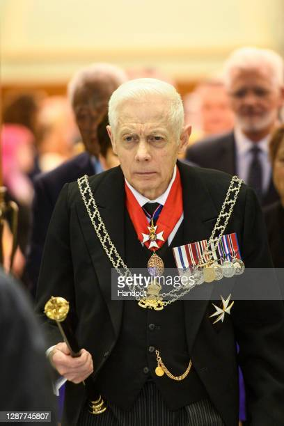 In this handout image provided by Mark Tantrum Photography New Zealand Herald of Arms Extraordinary to the Queen Phillip O'Shea arrives during the...