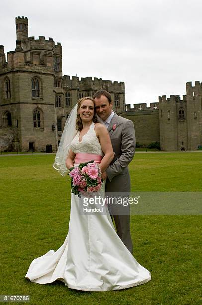 In this handout image provided by Matt Faber David Hewlett and Jane Loughman pose outside Warwick Castle during their wedding on June 21 2008 in...