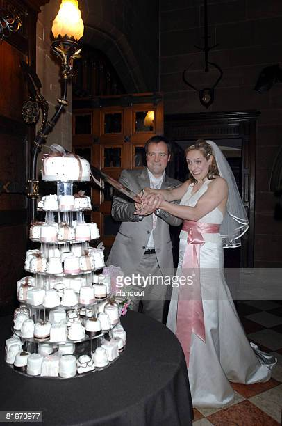 In this handout image provided by Matt Faber David Hewlett and Jane Loughman cut their wedding cake at Warwick Castle on June 21 2008 in Warwick...