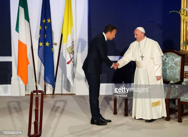 In this handout image provided by Maxwell Photography for 2018 WMOF2018 Pope Francis and Taoiseach Leo Varadkar shake hands in St Patrick's Hall at...