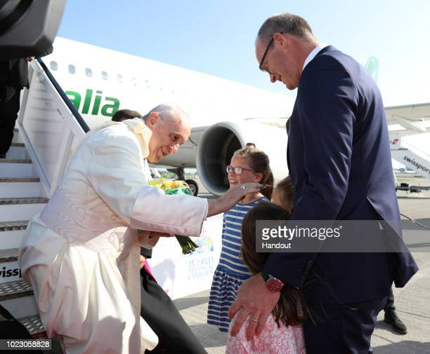 In this handout image provided by Maxwell Photography Pope Francis blesses the daughters of Foreign Affairs minister Simon Coveney as he arrives at...
