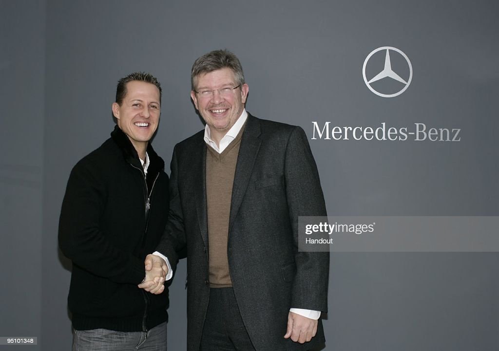In this handout image provided by Mercedes GP, Michael Schumacher shakes hands with team principal Ross Brawn on December 23, 2009 in Brackley, England. The Mercedes GP Petronas Formula One team have confirmed that 7-times Formula One World Champion Michael Schumacher will make his racing return in 2010 with the Silver Arrows team.