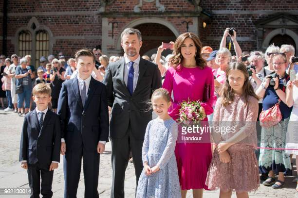 In this handout image provided by MEW and The National History Museum, Crown Prince Frederik of Denmark, Crown Princess Mary of Denmark with children...