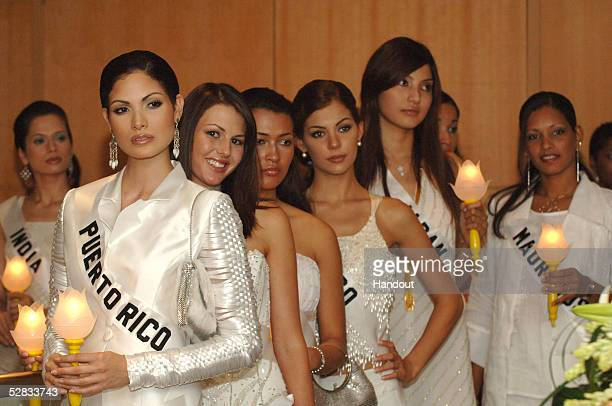 In this handout image provided by Miss Universe LP LLLP Amrita Thapar Miss India Universe 2005 Cynthia Olavarria Miss Puerto Rico Universe 2005 Adzle...