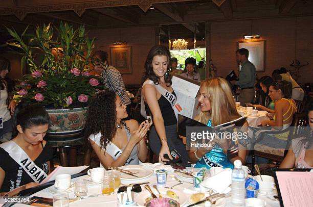 In this handout image provided by Miss Universe LP LLLP Chelsea Cooley Miss USA Universe 2005 hands out Until There's a Cure bracelets to Agnes'...