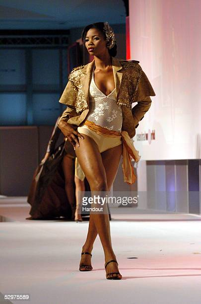 In this handout image provided by Miss Universe LP LLLP Roseline Amusu Miss Nigeria 2005 participates in a fashion show by BSC Swimsuits at...