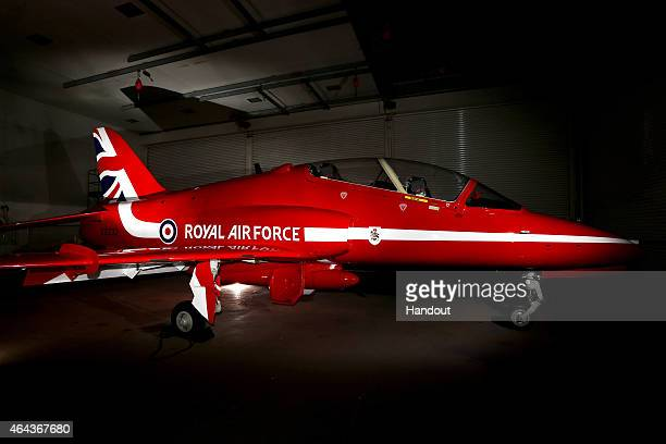 In this handout image provided by MoD Crown Copyright a Red arrow aeroplane from Hawk fleet featuring the new 2015 tail fin sit in a hangar at the...
