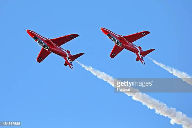 In this handout image provided by MoD Crown Copyright two Red arrow aeroplanes fly through the air featuring the new 2015 tail fin on November 26...