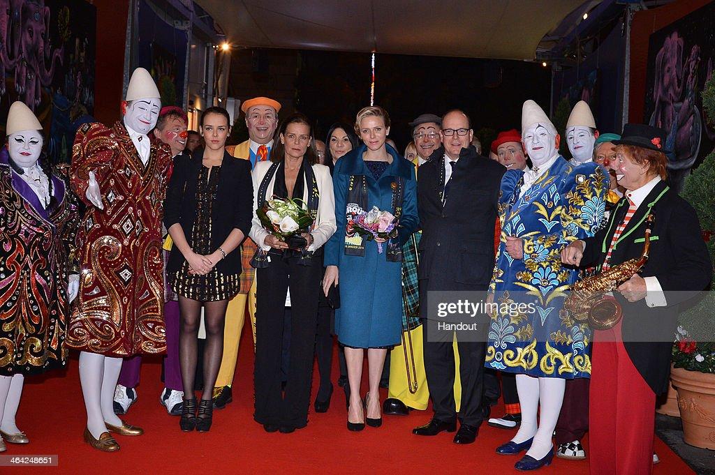 In this handout image provided by Monaco Centre de Presse, (L-R) Pauline Ducruet, Princess Stephanie of Monaco, Princess Charlene of Monaco and Prince Albert II of Monaco attend the 38th International Circus Festival on January 21, 2014 in Monte-Carlo, Monaco.