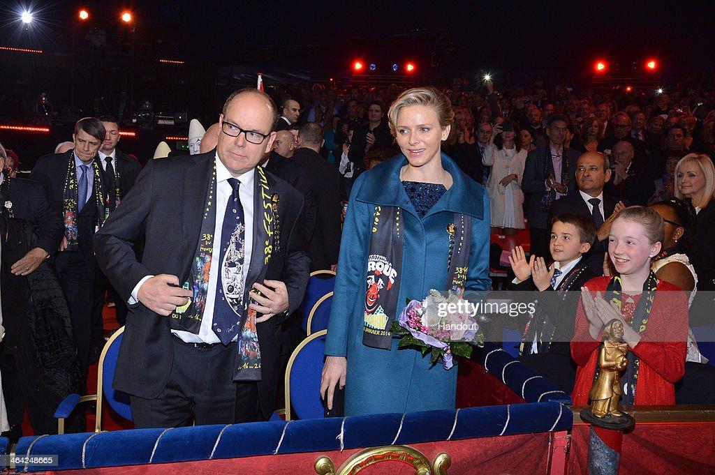 In this handout image provided by Monaco Centre de Presse, Prince Albert II of Monaco (L) and Princess Charlene of Monaco attend the 38th International Circus Festival on January 21, 2014 in Monte-Carlo, Monaco.