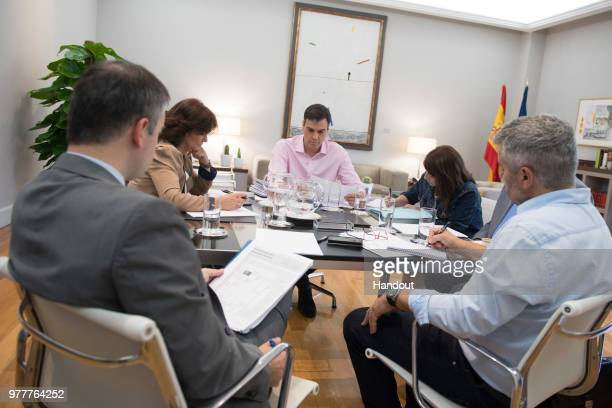 In this handout image provided by Moncloa Spanish Prime Minister Pedro Sanchez is seen during a meeting with Deputy Prime Minister Carmen Calvo and...