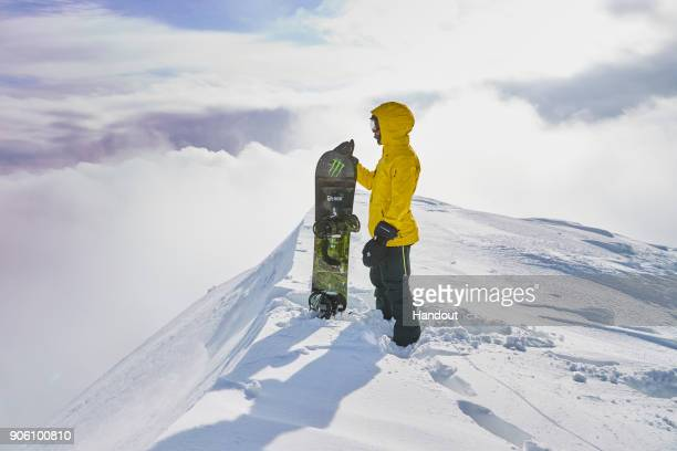 In this handout image provided by Monster Energy Fourtime F1 World Champion Lewis Hamilton hones his snowboarding skills with some of the world's...