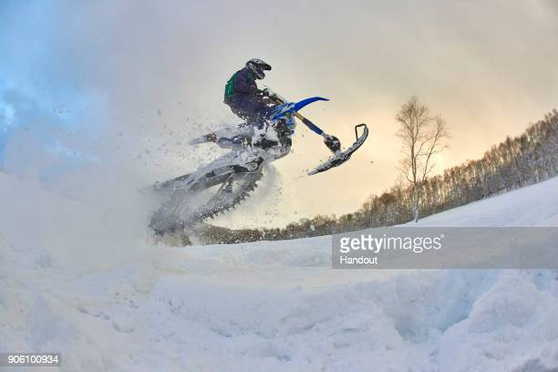 In this handout image provided by Monster Energy Fourtime F1 World Champion Lewis Hamilton makes a jump on a snowbike in January 2018 in Niseko...