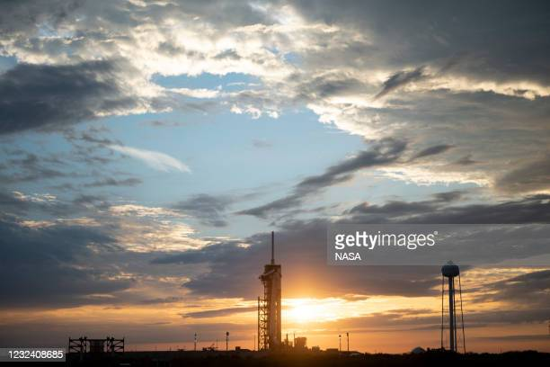 In this handout image provided by NASA, a SpaceX Falcon 9 rocket with the company's Crew Dragon spacecraft onboard is seen at sunset on the launch...