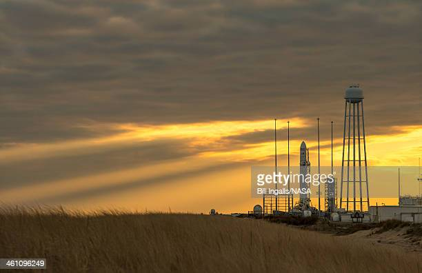 In this handout image provided by NASA an Orbital Sciences Corporation Antares rocket is seen on launch Pad0A at NASA's Wallops Flight Facility...