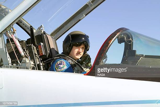 In this handout image provided by NASA, astronaut Mark E. Kelly, STS-121 pilot, in a T-38 trainer jet, prepares for a flight at Ellington Field near...