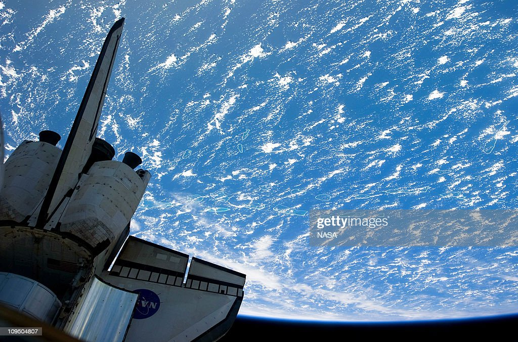 In this handout image provided by NASA, backdropped by a blue and white part of Earth, the aft section of space shuttle Discovery, currently docked with the International Space Station February 26, 2011 in Space. Discovery, on its 39th and final flight, is carrying the Italian-built Permanent Multipurpose Module (PMM), Express Logistics Carrier 4 (ELC4) and Robonaut 2, the first humanoid robot in space to the International Space Station.