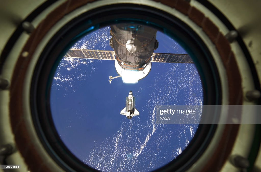 In this handout image provided by NASA, backdropped by a blue and white part of Earth, space shuttle Discovery approaches the International Space Station during STS-133 rendezvous and docking operations February 26, 2011 in Space. Discovery, on its 39th and final flight, is carrying the Italian-built Permanent Multipurpose Module (PMM), Express Logistics Carrier 4 (ELC4) and Robonaut 2, the first humanoid robot in space to the International Space Station.
