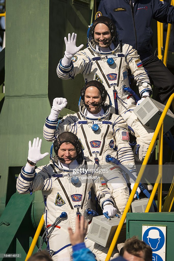 In this handout image provided by NASA, Expedition 33/34 crew members, (L-R) Soyuz Commander Oleg Novitskiy, Flight Engineer Kevin Ford of NASA, and Flight Engineer Evgeny Tarelkin of ROSCOSMOS, wave farewell before boarding their Soyuz rocket just a few hours before their launch to the International Space Station on October 23, 2012, in Baikonur, Kazakhstan. Launch of a Soyuz rocket will send Ford, Novitskiy and Tarelkin on a five-month mission aboard the International Space Station.