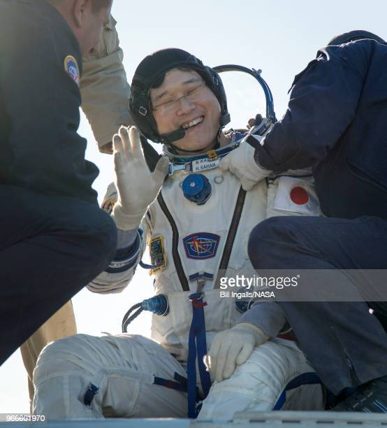 In this handout image provided by NASA Japan Aerospace Exploration Agency astronaut Norishige Kanai is helped out of the Soyuz MS07 spacecraft just...