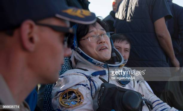 In this handout image provided by NASA Japan Aerospace Exploration Agency astronaut Norishige Kanai rest in a chair outside the Soyuz MS07 spacecraft...