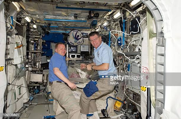 In this handout image provided by NASA, NASA astronaut Eric Boe , STS-133 pilot; and European Space Agency astronaut Paolo Nespoli, Expedition 26...