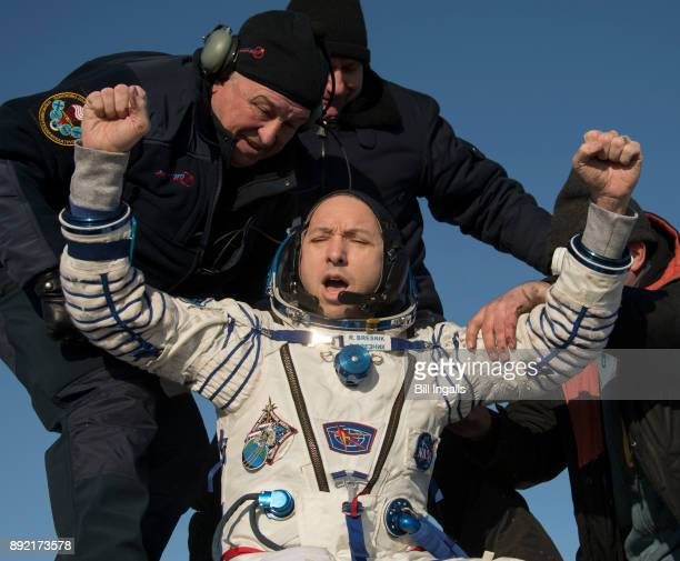 In this handout image provided by NASA NASA astronaut Randy Bresnik is helped out of the Soyuz MS05 spacecraft just minutes after he ESA astronaut...